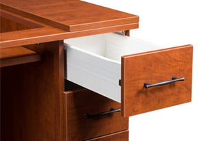 Desk with a drawer pulled out.
